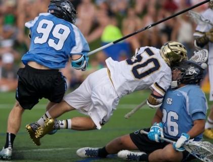Hit from the behind after the play, Matt Kavanagh meets goalie Kieran Burke